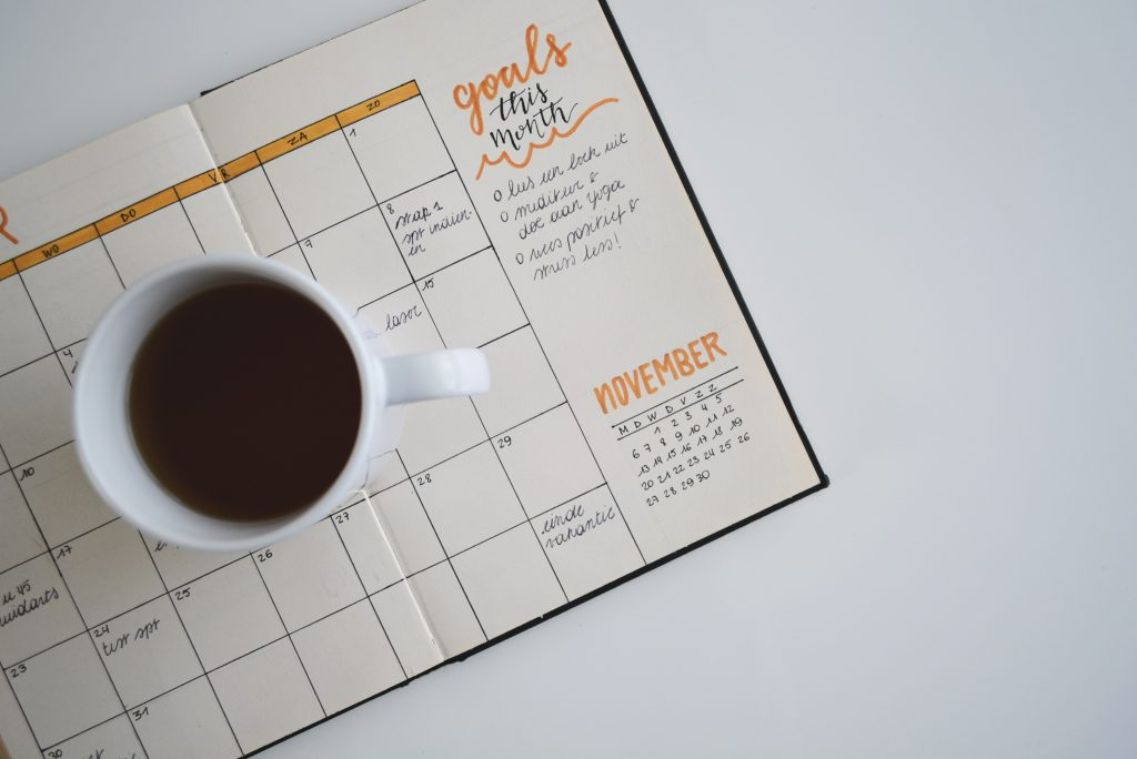 Calendar on desk with coffee cup